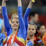 Romania's Anamaria Tamirjan waves to the crowd after she and her teammates won the bronze in the women's team final of the artistic gymnastics event of the Beijing 2008 Olympic Games in Beijing on August 13, 2008.  China won the gold, while United States won the silver and Romania the bronze.  AFP PHOTO / LLUIS GENE (Photo credit should read LLUIS GENE/AFP/Getty Images)